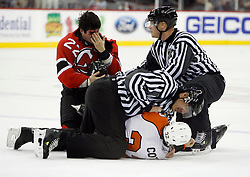 November 8, 2007; Newark, NJ, USA;  New Jersey Devils right wing Arron Asham (22) checks his cut after his fight against Philadelphia Flyers left wing Riley Cote (32) fight during the first period at the Prudential Center in Newark, NJ.