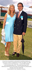 COUNT & COUNTESS ALLESANDRO GUERRINI-MARALDI, at a polo match in Berkshire on 27th July 2003.PLU 295