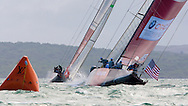 NEW ZEALAND, Auckland, 11th February 2009, Louis Vuitton Pacific Series, Challenger Final Race 2, Alinghi vs BMW Oracle Racing, Alinghi lead BMW Oracle Racing round the leeward mark.