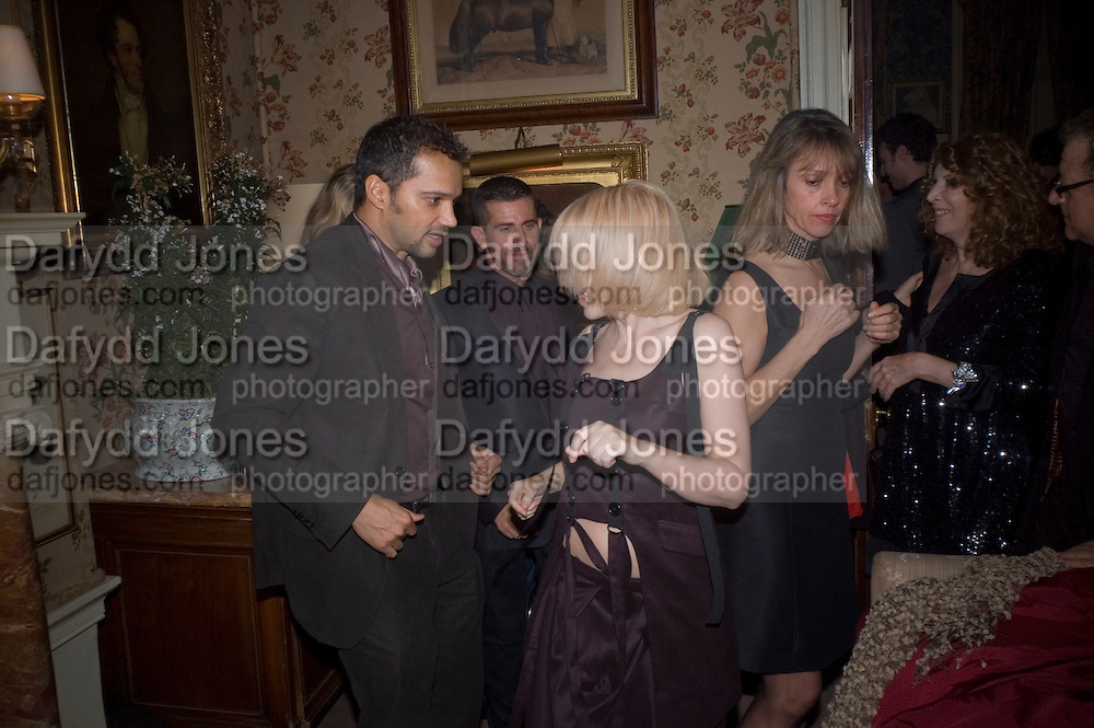 KYLIE MINOGUE AND GERRY DE VAUX, Pre Bafta dinner hosted by Charles Finch and Chanel. Mark's Club. Charles St. London. 9 February 2008.  *** Local Caption *** -DO NOT ARCHIVE-© Copyright Photograph by Dafydd Jones. 248 Clapham Rd. London SW9 0PZ. Tel 0207 820 0771. www.dafjones.com.