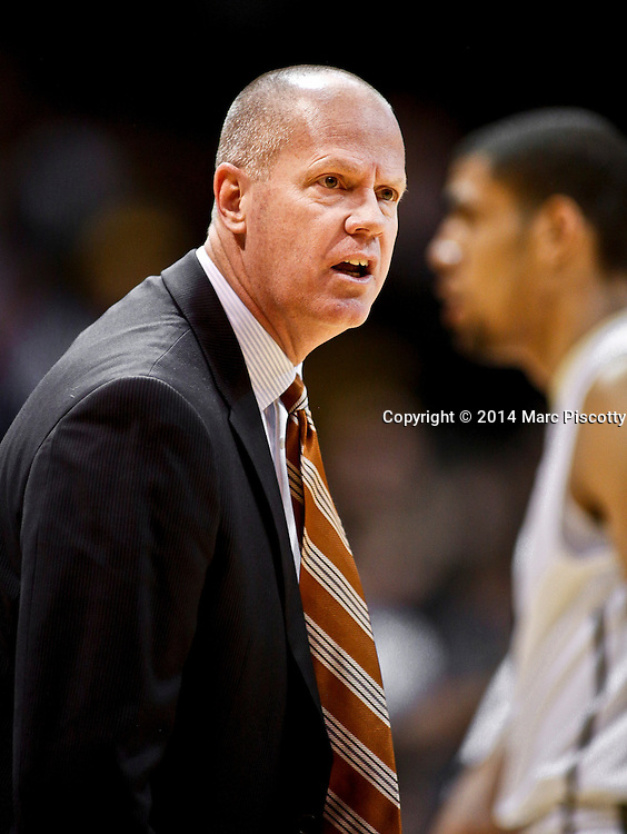 SHOT 2/19/14 10:21:52 PM - Colorado head basketball coach Tad Boyle questions a call by the referees during a game against Arizona State in their regular season Pac-12 basketball game at the Coors Events Center in Boulder, Co. Colorado won the game 61-52.<br /> (Photo by Marc Piscotty / &copy; 2014)