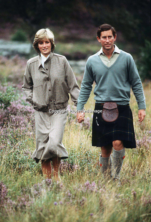 Charles, Prince of Wales and Diana, Princess of Wales on the banks of the river Dee during their honeymoon at Balmoral, Scotland in August 1981. Diana wearing warm tweeds and Charles in a kilt  agree to meet the press and pose by the river. <br /> Balmoral, GREAT BRITAIN - 08/1981