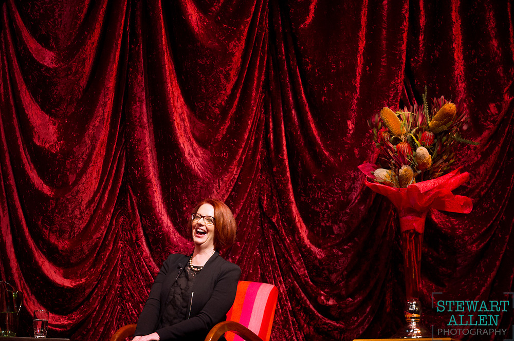 Spot News <br /> Stewart Allen<br /> The Sunday Times<br /> Prime Minister Julia Gillard finds herself on a red chair, with a red background and red flowers during an interview with comedian Ben Elton in Fremantle.