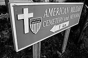 Colleville sur Mer | Oct 15 2009..A Roadsign pointing to the American Military Cementery is seen in the french village of Colleville sur Mer. Colleville sur Mer was one of the first villages to be freed by Allied Forces entering Europe on June 6, 1944 (D-Day).  ..Photo: juelich/ip-photo.com