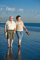 Senior couple walking on beach