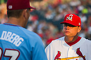 Manager Mike Shildt (8) of the Springfield Cardinals talks with Brian Poldberg (27) of the Northwest Arkansas Naturals during the pre game meeting prior to a game at Hammons Field on August 23, 2013 in Springfield, Missouri. (David Welker)