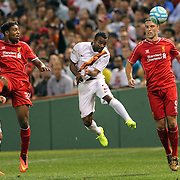 Ashley Cole, (centre), AS Roma, wins a header from Jordon Ibe, (left), and Rickie Lambert, Liverpool, during the Liverpool Vs AS Roma friendly pre season football match at Fenway Park, Boston. USA. 23rd July 2014. Photo Tim Clayton