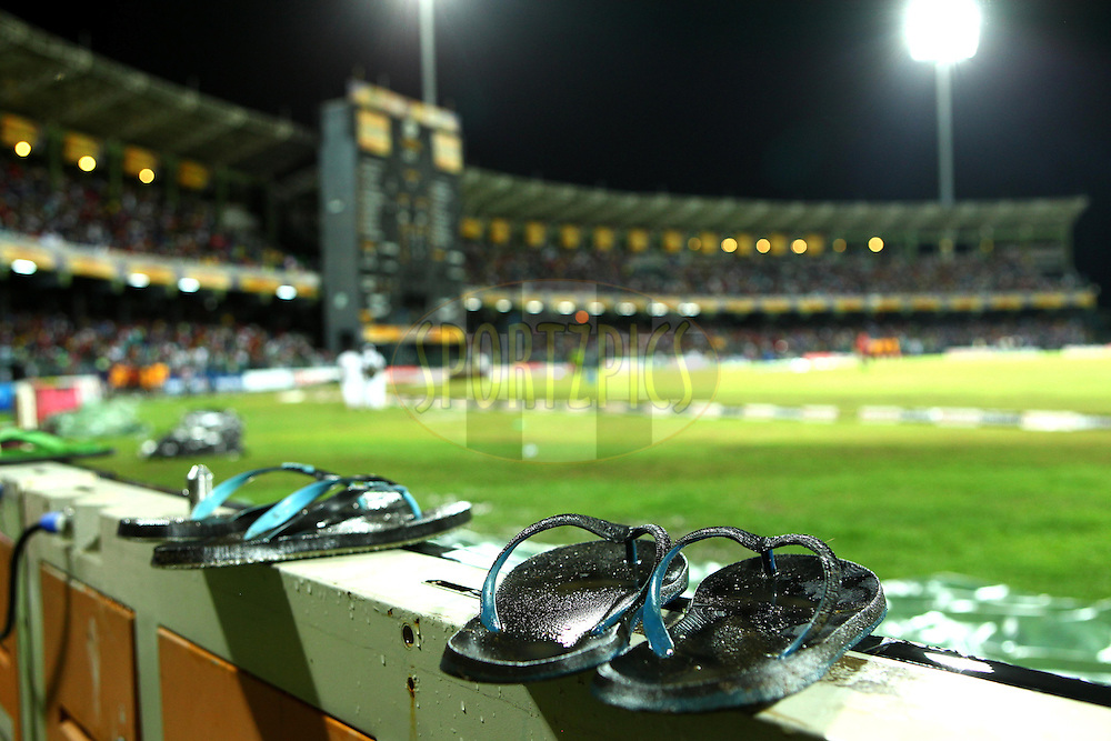 Groundstaff slops rest on the electronic advertising boards in the rain break during the Final Match of the Sri Lankan Premier League between Uva Next and Nagenahira Nagas held at the Premadasa Stadium in Colombo, Sri Lanka on the 31st August 2012. .Photo by Ron Gaunt/SPORTZPICS/SLPL
