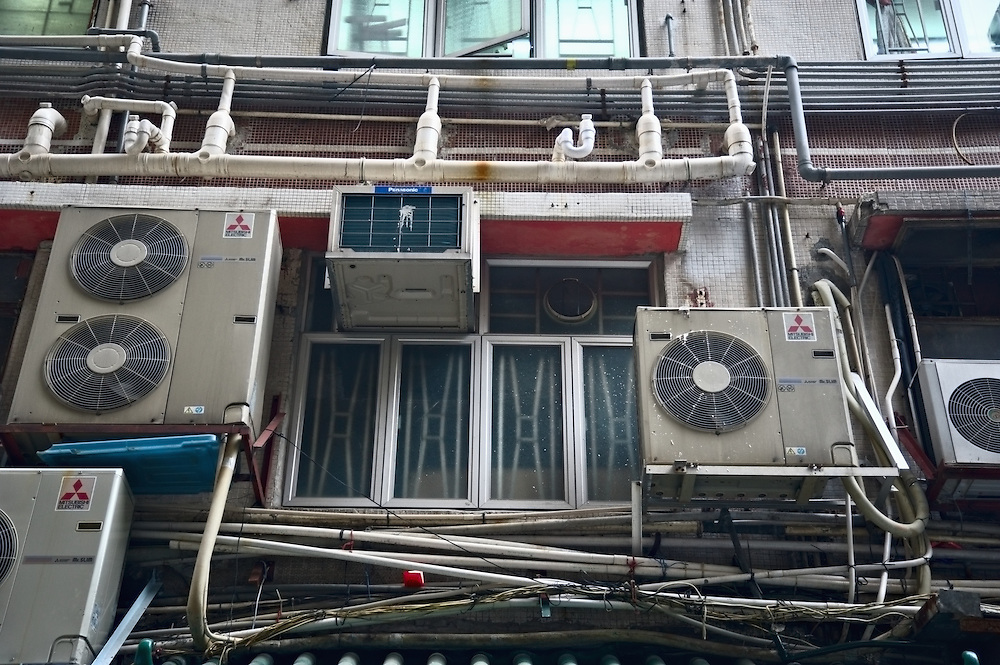 Air conditioners and exposed pipes and wiring on apartment building, Upper Lascar Row, Hong Kong's Central district