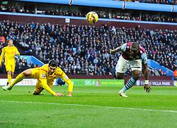 Liverpool's Emre Can is fouled by Aston Villa's Jores Okore  - Photo mandatory by-line: Joe Meredith/JMP - Mobile: 07966 386802 - 17/01/2015 - SPORT - Football - Birmingham - Villa Park - Aston Villa v Liverpool - Barclays Premier League