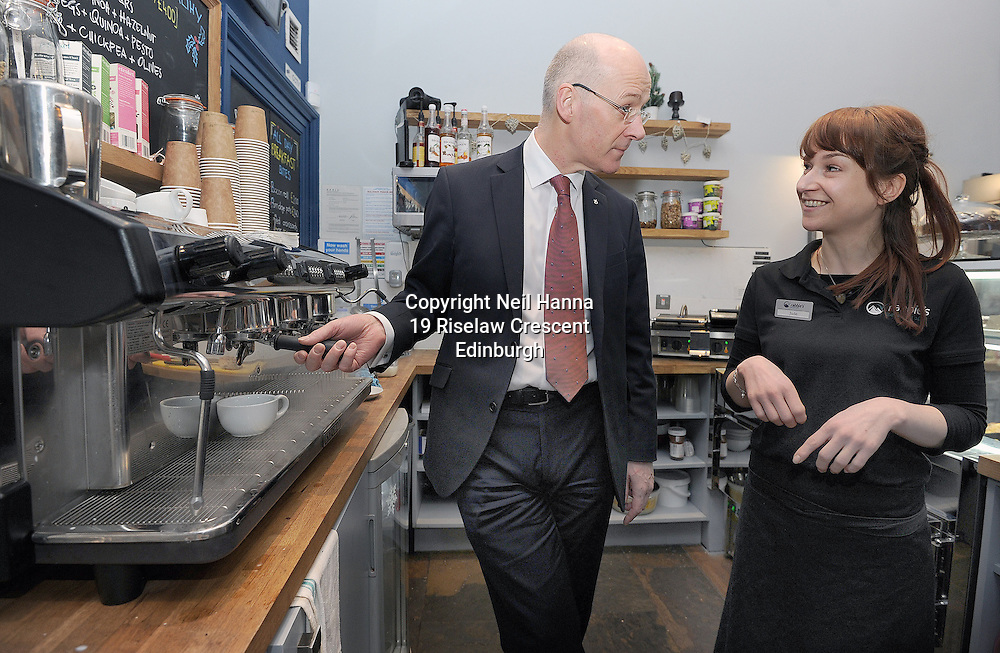 Edinburgh 08/1/2015<br /> <br /> Deputy First Minister John Swinney  visited Rabbie's Tours in Edinburgh today to hear how their decision to become a Living Wage Accredited employer has strengthened their business. Mr Swinney  meet with senior management and staff including Rabbie's Cafe staff Rachel Robson (curly hair) and Jude Sevestre who shared their coffee making techniques to Mr Swinney<br /> <br />  Later today Mr Swinney will address parliament in the Boosting the Economy debate where he will set out the actions of the Scottish Government in boosting economic growth and tackling inequality.<br /> <br /> Rabbie's believe that the Living Wage is good for employees and their families, good for Rabbie's and good for the wider economy. The company is already benefitting by seeing greater staff engagement.<br /> <br /> <br /> <br />  Neil Hanna Photography<br /> www.neilhannaphotography.co.uk<br /> 07702 246823
