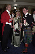 Anthony Burrell, Lady Louise Burrell and Viscount Dupplin. the Royal Caledonian Ball. 2001. Grosvenor house. London. 3 May 2001. © Copyright Photograph by Dafydd Jones 66 Stockwell Park Rd. London SW9 0DA Tel 020 7733 0108 www.dafjones.com