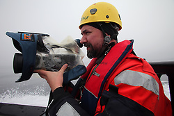 LABRADOR SEA 16JUN11 - Cameraman Brandan Edgens of the USA during boat training from aboard the Greenpeace ship Esperanza in the Davis Stait off the coast of Greenland...Photo by Jiri Rezac / Greenpeace