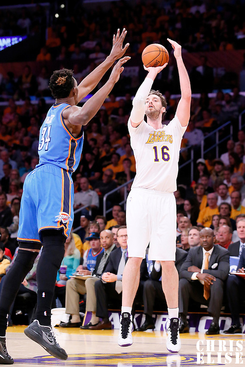 09 March 2014: Los Angeles Lakers center Pau Gasol (16) takes a jumpshot over Oklahoma City Thunder center Hasheem Thabeet (34) during the Los Angeles Lakers 114-110 victory over the Oklahoma City Thunder at the Staples Center, Los Angeles, California, USA.
