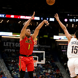 Mar 26, 2019; New Orleans, LA, USA; Atlanta Hawks guard Justin Anderson (1) shoots over New Orleans Pelicans guard Frank Jackson (15) during the second quarter at the Smoothie King Center. Mandatory Credit: Derick E. Hingle-USA TODAY Sports