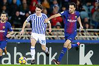 Real Sociedad's Alvaro Odriozola (l) and FC Barcelona's Sergio Busquets during La Liga match. January 14,2018. (ALTERPHOTOS/Acero)