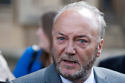 © Licensed to London News Pictures. 16/04/2012. LONDON, UK. George Galloway talks to the assembled media outside the houses of Parliament ahead of his being sworn in as the Respect Party's MP for Bradford West. Photo credit: Matt Cetti-Roberts/LNP