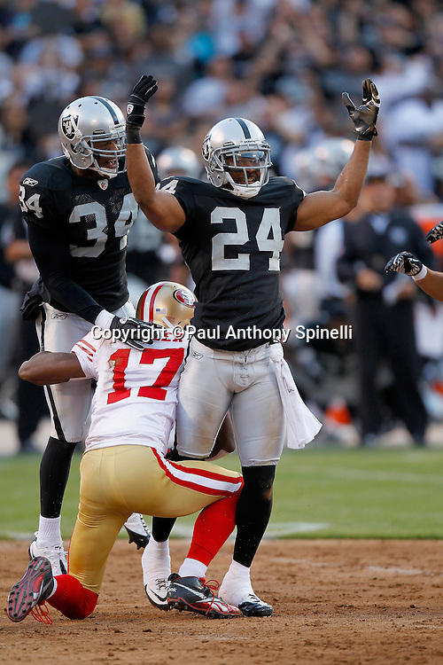 Oakland Raiders safety Michael Huff (24) celebrates after a big hit on San Francisco 49ers wide receiver Dominique Zeigler (17) during the NFL preseason week 3 football game against the San Francisco 49ers on Saturday, August 28, 2010 in Oakland, California. The 49ers won the game 28-24. (©Paul Anthony Spinelli)
