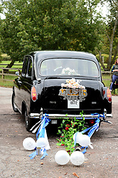 Former Prime Minister Tony Blair's Son Euan Blair Wedding to Suzanne Ashman at All Saints Church in  Wotton Underwood, United Kingdom. Saturday, 14th September 2013. Picture by Ben Stevens / i-Images<br /> <br /> Pictured is the wedding car leaving All Saints Church.