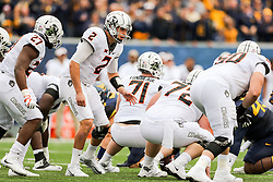 Oct 28, 2017; Morgantown, WV, USA; Oklahoma State Cowboys quarterback Mason Rudolph (2) changes the play during the first quarter against the West Virginia Mountaineers at Milan Puskar Stadium. Mandatory Credit: Ben Queen-USA TODAY Sports