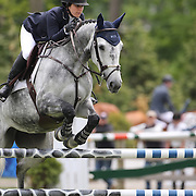 Sydney Shulman riding Toscane De L'isle in action during the $35,000 Grand Prix of North Salem presented by Karina Brez Jewelry during the Old Salem Farm Spring Horse Show, North Salem, New York, USA. 15th May 2015. Photo Tim Clayton