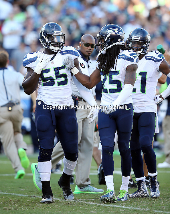 Seattle Seahawks rookie defensive end Frank Clark (55) gets a pat on the chest from Seattle Seahawks cornerback Richard Sherman (25) during the 2015 NFL preseason football game against the San Diego Chargers on Saturday, Aug. 29, 2015 in San Diego. The Seahawks won the game 16-15. (©Paul Anthony Spinelli)
