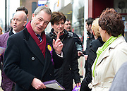 © Licensed to London News Pictures. 12/02/2013. Eastleigh, UK NIGEL FARAGE (red scarf) and DIANE JAMES. Diane James, chosen yesterday to fight the Eastleigh by election for UKIP, campaigns with Nigel Farage, leader of the party, in Easleigh's Market Street today 12th February 2013. Photo credit : Stephen Simpson/LNP