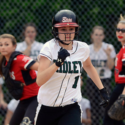 Staff photos by Tom Kelly IV<br /> Ridley's Mel Malseed (1) lays down a bunt and is safe at first as the first baseman dropped her glove with the ball inside as it made contact with the back of Malseed's head during the Hatboro-Horsham at Ridley softball game on Monday afternoon.