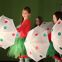 "Adam Robison | BUY AT PHOTOS.DJOURNAL.COM<br /> Saltillo Elementary School students, perform in their Santa Tracker program Wednesday morning in the School's multipurpose building during the song, ""It's Raining Men"" to represent the county of Brazil due to its heavy rain fall. The program covered types of weather and climates in different locations throughout the world and weather tools. The school used items in the program that were purchased with an ExPECT grant."