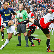 NLD/Rotterdam/20100919 - Voetbalwedstrijd Feyenoord - Ajax 2010, Mounir El Hamdaoui in duel met Stefan de Vrij