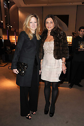 Left to right, CHRISTINA BOOTHE and ELLA KRASNER at a party to celebrate the publication of Nathalie von Bismarck's book 'Invisible' held at Asprey, 167 New Bond Street, London on 9th December 2010.