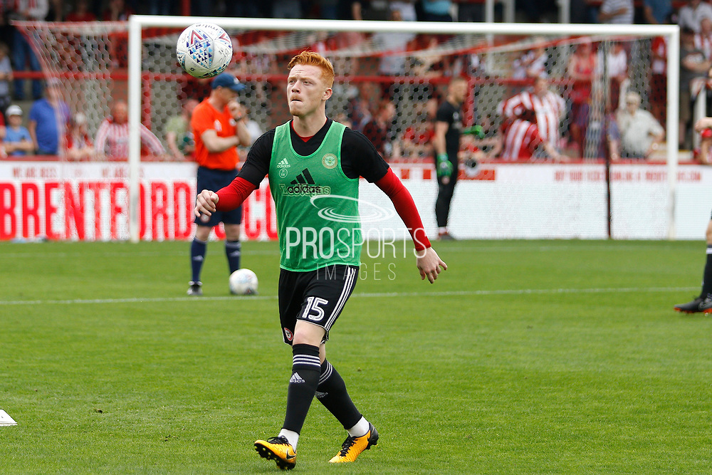 Brentford Midfielder Ryan Woods (15) warms up before kick off during the EFL Sky Bet Championship match between Brentford and Queens Park Rangers at Griffin Park, London, England on 21 April 2018. Picture by Andy Walter.