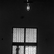 A child peers into the sanctuary of the Methodist church on the Maleku Indigenous reservation in Tonjibe, Costa Rica.