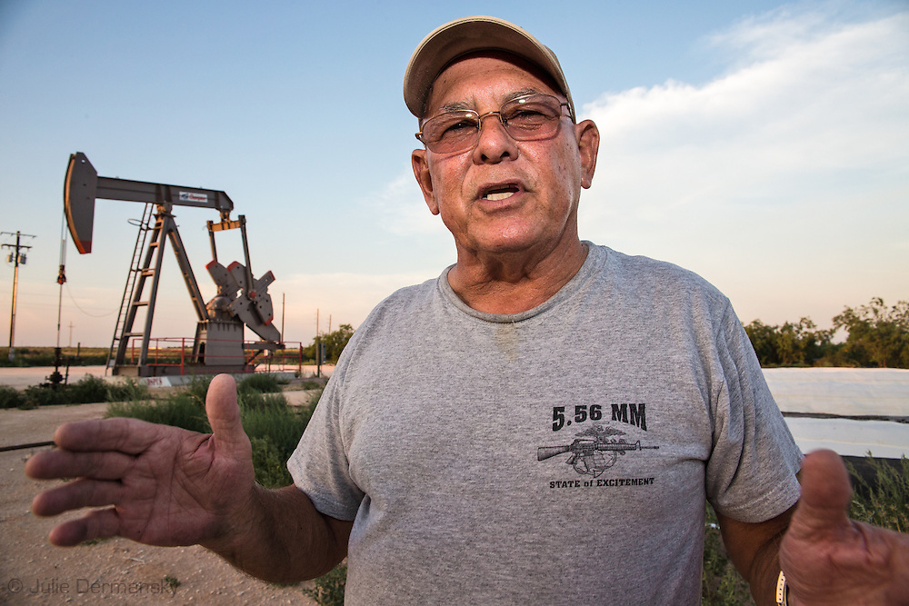 Arthur Dehilinger's stands near a drilling rig left behind at a frackstie on his land in Big Spring Texas. Dehilinger does not own his mineral rights on the 45 acres of land his home is on so he was unable to prevent fracksites in his backyard.  There are seven wells on the land that he has no control on , and more could be drilled at any time. During the drilling, the noise, vibrations , air pollution and bright lights made it impossible for him to enjoy his home .He  worries about the water from his well  running out since one of his neighbor uses a well near by to sell industry water from the same aquifer his well is tapped into.