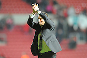 Derby County manager Darren Wassall applauds the fans at the end of his teams 3-2 win over Bristol City during the Sky Bet Championship match between Bristol City and Derby County at Ashton Gate, Bristol, England on 19 April 2016. Photo by Graham Hunt.