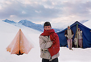 Lowland porters after a snowstorm. Dolpo, Nepal.