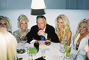 Hugh Hefner and some of his favorite  bunnies in the background.  Talk magazine pre-Golden Globes party. Mondrian Hotel. 20 January 2001. © Copyright Photograph by Dafydd Jones 66 Stockwell Park Rd. London SW9 0DA Tel 020 7733 0108 www.dafjones.com