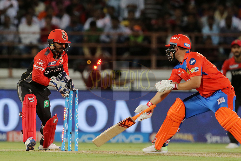 Kedar Jadhav of the Royal Challengers Bangalore stumps out Aaron Finch of the Gujarat Lions during match 20 of the Vivo 2017 Indian Premier League between the Gujarat Lions and the Royal Challengers Bangalore  held at the Saurashtra Cricket Association Stadium in Rajkot, India on the 18th April 2017<br /> <br /> Photo by Vipin Pawar - Sportzpics - IPL