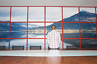 Man Staring at Wall Photo in Conference Room back view