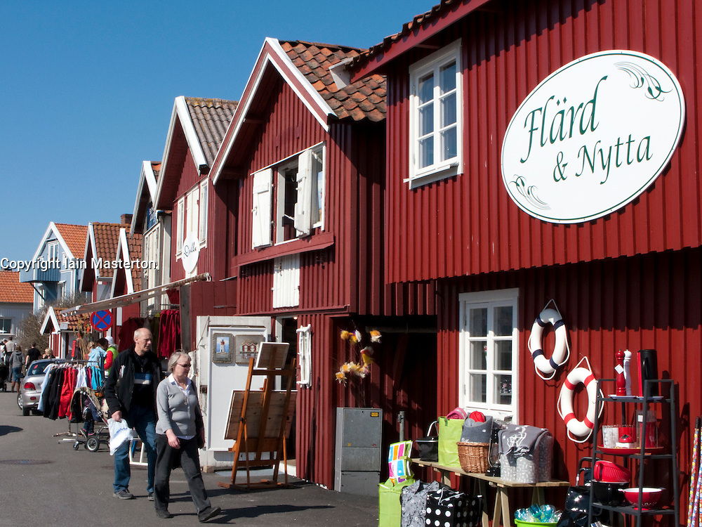Tourist shops in Traditional red wooden buildings in village of Smogen on Swedens Bohuslan coast