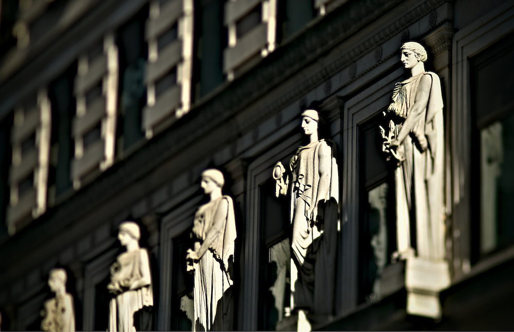 Statues on facade of old skyscraper
