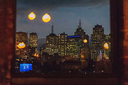 Melbourne Victoria Australia skyline from Naked in the Sky roof terrace at Naked for Satan bar Brunswick St, Fitzroy