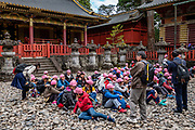 "School kids group. Toshogu Shrine is the final resting place of Tokugawa Ieyasu, the founder of the Tokugawa Shogunate that ruled Japan for over 250 years until 1868. Ieyasu is enshrined at Toshogu as the deity Tosho Daigongen, ""Great Deity of the East Shining Light"". Initially a relatively simple mausoleum, Toshogu was enlarged into the spectacular complex seen today by Ieyasu's grandson Iemitsu during the first half of the 1600s. The lavishly decorated shrine complex consists of more than a dozen buildings set in a beautiful forest. Countless wood carvings and large amounts of gold leaf were used to decorate the buildings in a way not seen elsewhere in Japan. Toshogu contains both Shinto and Buddhist elements, as was common until the Meiji Period when Shinto was deliberately separated from Buddhism. Toshogu is part of Shrines and Temples of Nikko UNESCO World Heritage site."