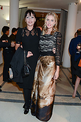 Left to right, PEARL LOWE and DONNA AIR at the Macmillan De'Longhi Art Auction 2013 held at the Royal College of Art, London on 23rd September 2013.