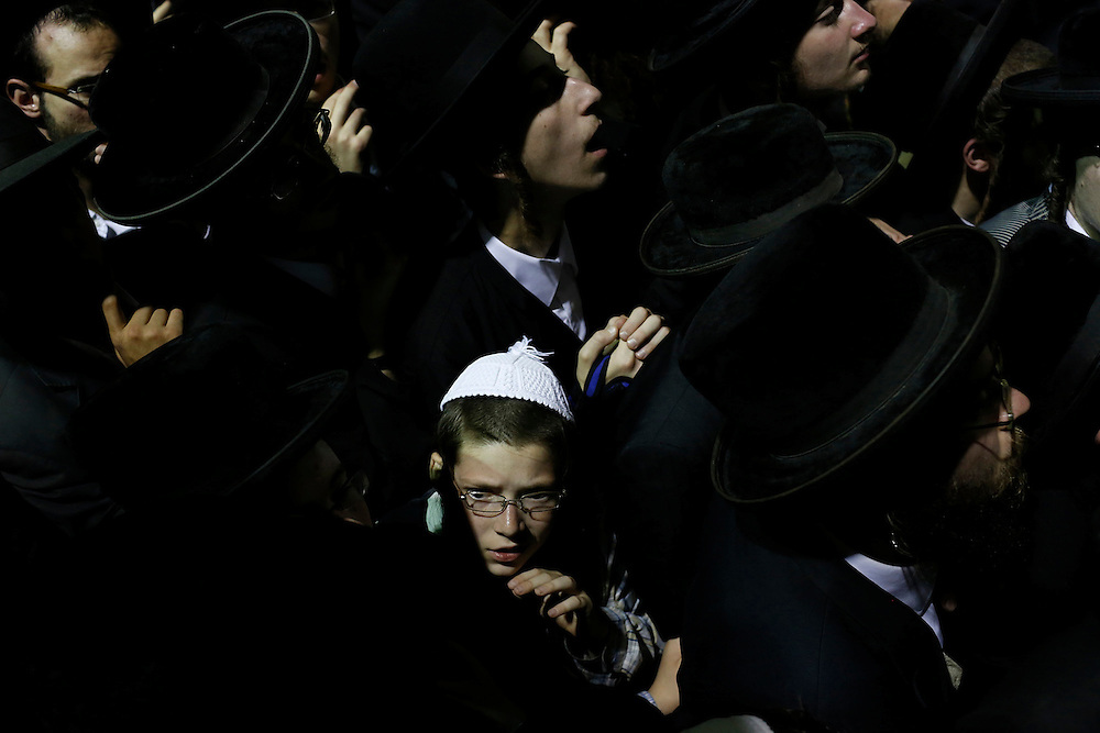 Ultra-Orthodox Jews attend the funeral of Abraham Wallace in Jerusalem's Mea Shearim neighbourhood, Israel.