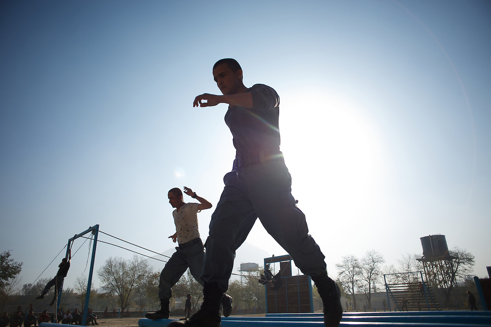 November 14, 2012 - Kabul, Afghanistan: Afghan National Police (ANP) cadets during morning endurance exercises at the Afghan Nacional Police Academy...ANP Academy trains 1250 cadets at the time during a period of four years. Every year, five hundred new recruits are selected, out of more than nine thousand of candidates, to join the academy and other five hundred graduate. Fifteen per cent of the recruits are women. (Paulo Nunes dos Santos/Polaris)