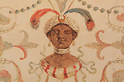 """Detail of a painted decorative wall panel depicting figure with turban, earrings and feathers, probably a eunuch, Turkish Boudoir, redesigned in 1777 for Marie Antoinette, by architect Richard Mique, Chateau de Fontainebleau, France. The decoration is the achievement of the brothers Rousseau, and the furniture dates to the period of the First Empire, with precious textile work done by Jacob-Desmalter for Empress Josephine. Including a small bedroom, mirrors, and curtains raised by pulleys, this exceptional ensemble has been restored in 2014 thanks to the support of INSEAD and the generosity of subscribers of sponsors belonging to the group """"Des Mécènes pour Fontainebleau"""". Its opening to the public is schedule for Spring 2015. Picture by Manuel Cohen"""