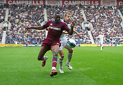 PRESTON, ENGLAND - Saturday, September 24, 2011: Tranmere Rovers' Lucas Akins in action against Preston North End's Paul Parry during the Football League One match at Deepdale. (Pic by Dave Kendall/Propaganda)