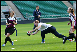 Prince Harry takes part in a Rugby Football Union schools coaching session at Twickenham Stadium in London, Thursday, 17th October 2013. Picture by Stephen Lock / i-Images