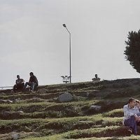 A couple sit together near the coast of Izmir, Turkey.